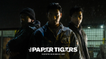 The Paper Tigers movie poster with three men standing in the rain at night